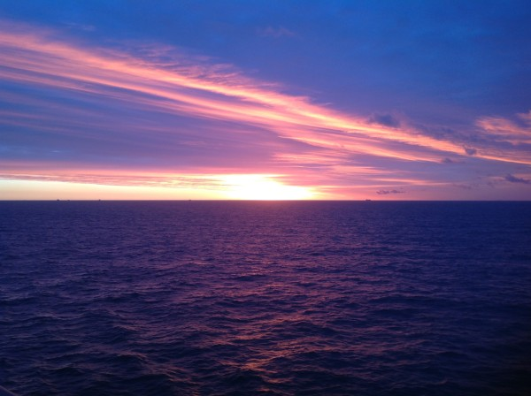 Gorgeous sunrise - colors on the water and ships on the horizon.